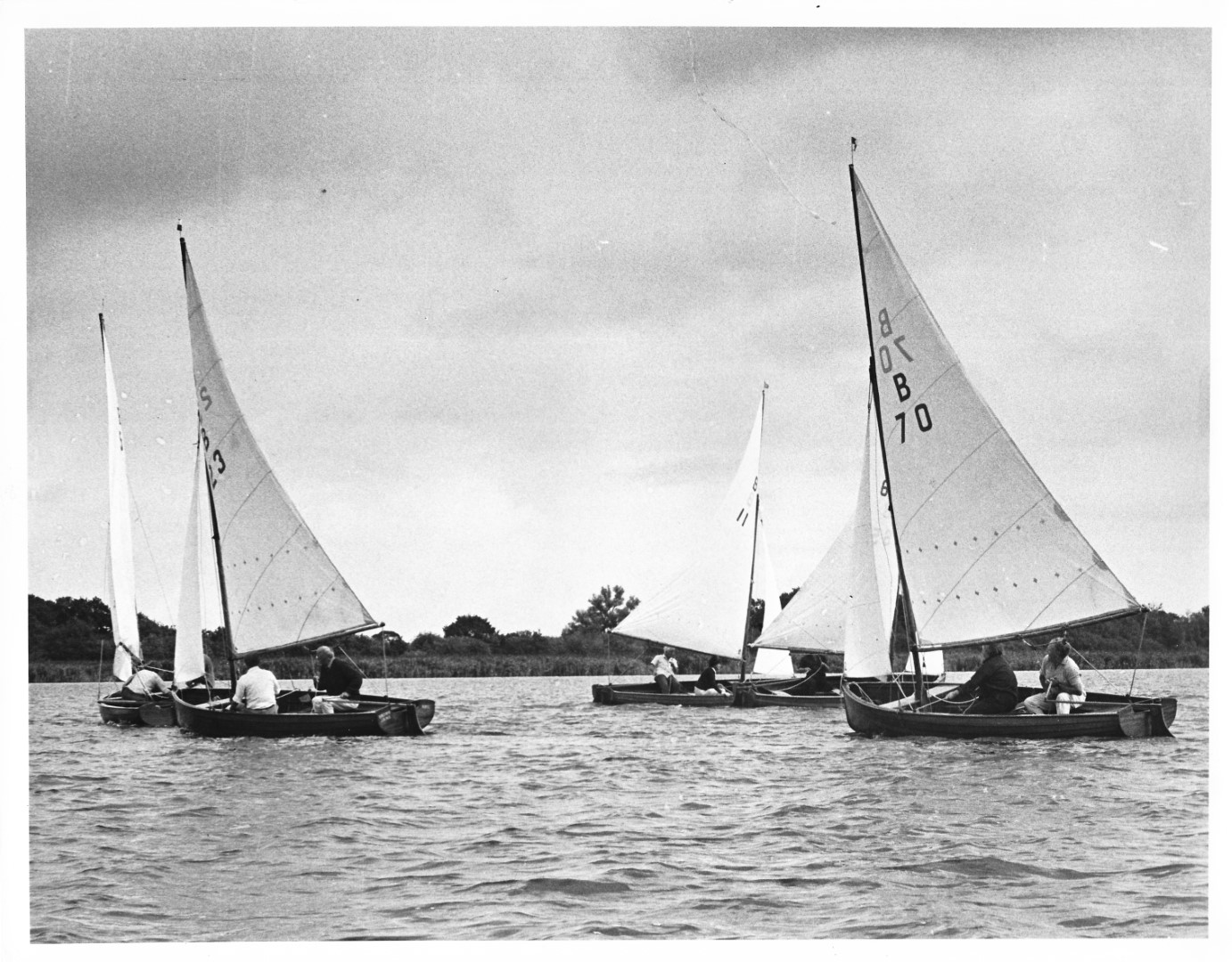 Norfolk Dingies round a buoy in the first race - Championships 1975